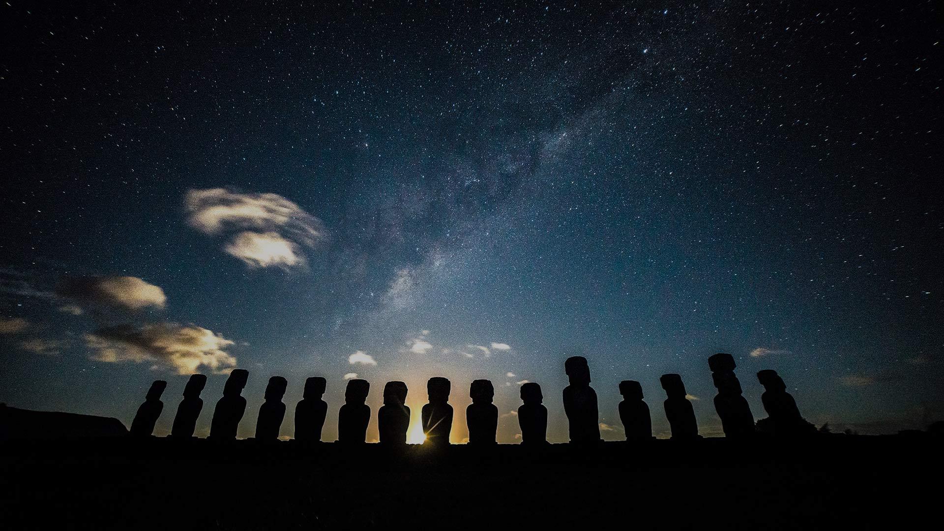Ahu Tongariki sunrise with stars moon 25% black